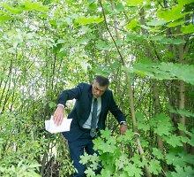 Įžūlūs vilniečiai užgrobtą valstybinę žemę greta Neries saugo su šunimis