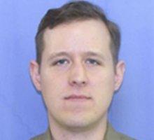 Jungtinėse Valstijose per didelio masto gaudynes sučiuptas įtariamas policininko žudikas