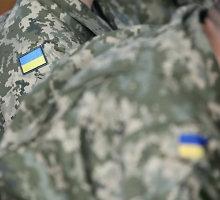 Kanada aprengs Ukrainos karius žieminiais rūbais