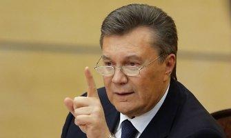 Užsienio bankuose įšaldytas milijardas dolerių, priklausančių Viktoro Janukovyčiaus aplinkai
