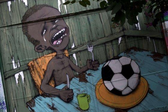 """AFP/""""Scanpix"""" nuotr./Grafičiai Brazilijos miestuose"""