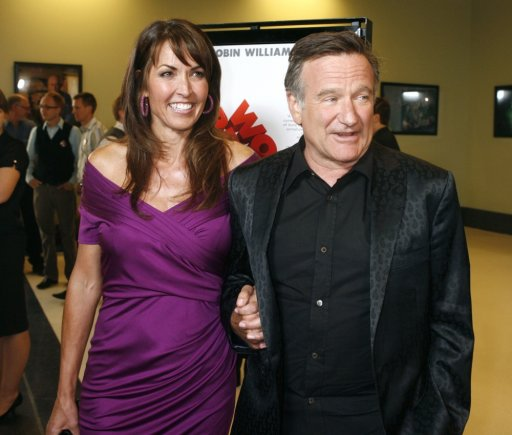 """Reuters""/""Scanpix"" nuotr./Robinas Williamsas su trečiąja žmona Susan Schneider (2009 m.)"