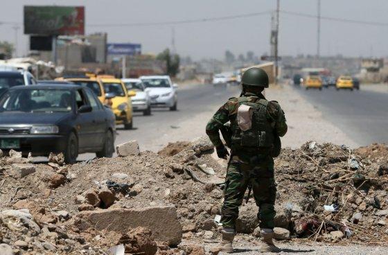 """AFP/""""Scanpix"""" nuotr./Džihadistų kovotojas Irake"""