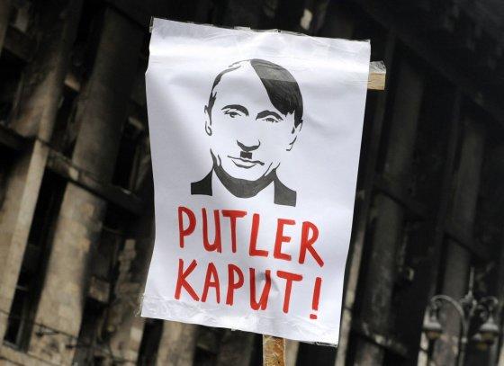 """""""Reuters""""/""""Scanpix"""" nuotr./Protestas prieš Rusiją"""