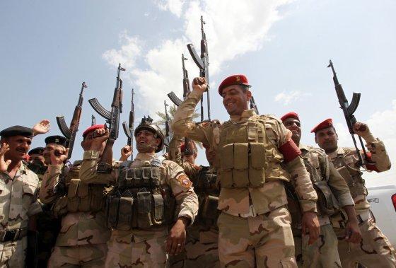 "AFP/""Scanpix"" nuotr./Irako armijos kariai"