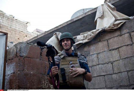 """""""Scanpix""""/""""SIPA"""" nuotr./JAV žurnalistas Jamesas Foley"""
