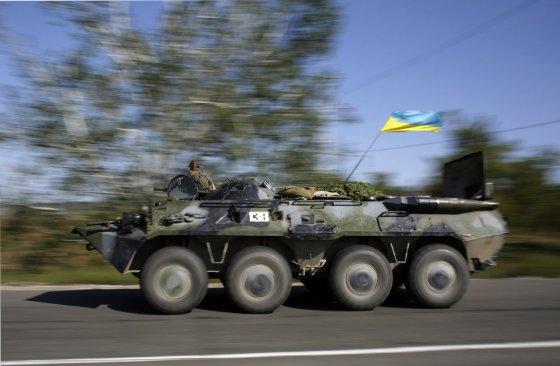 """AFP/""""Scanpix"""" nuotr./Ukrainos kariai"""