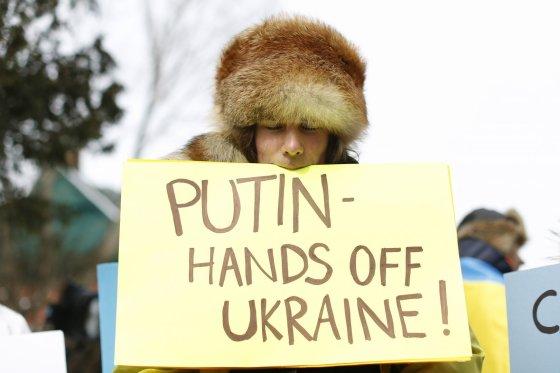 """""""Reuters""""/""""Scanpix"""" nuotr./Plakatas, skirtas V.Putinui"""