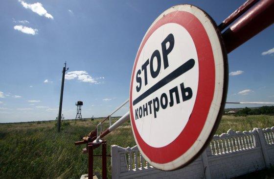 """AFP/""""Scanpix"""" nuotr./Rusijos sankcijos turės įtakos Lietuvos darbo rinkai"""