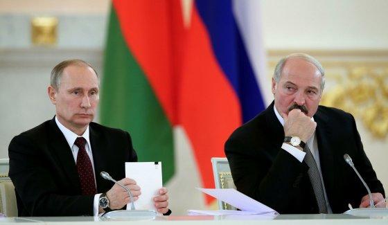 "AFP/""Scanpix"" nuotr./Vladimiras Putinas ir Aliaksandras Lukašenka"