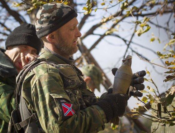 """""""Reuters""""/""""Scanpix"""" nuotr./Donecko oro uostą atakuojantys smogikai"""