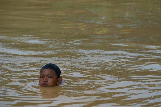 """AFP/""""Scanpix"""" nuotr./Potvyniai Malaizijoje"""