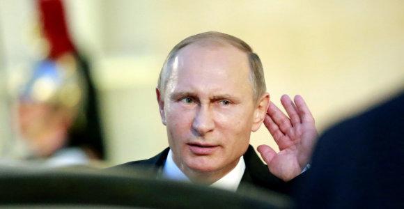"""Ph.Hammondas: """"V.Putinas karą Sirijoje galėtų pabaigti vienu telefono skambučiu"""""""