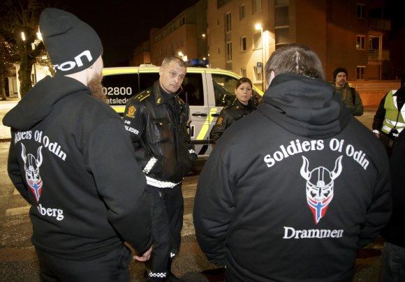 """""""Scanpix""""/AP nuotr./""""Odino karių"""" savanoriai Norvegijoje ir Suomijoje"""